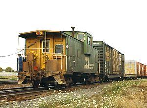 300px-BN_caboose,_Eola_Yard,_1993